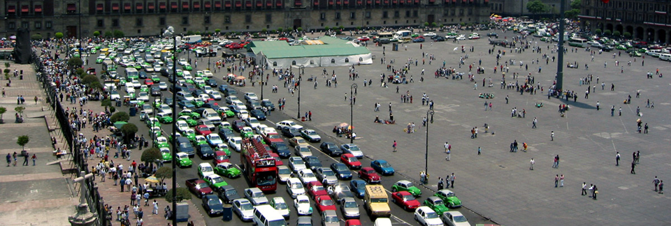 Photo of traffic jam at Zocalo with facade of National Palace